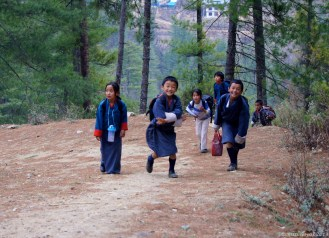 Relieved or released? Children leaving school excitedly near Dodena, Thimpu